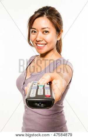 young asian woman with remote conrol