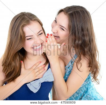 woman's secret, two young beautiful women friends whisper funny news