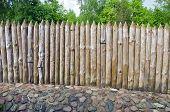 stock photo of log fence  - old wooden log fence in resort park - JPG