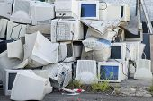 stock photo of waste disposal  - Electronic waste a large pile of unwanted computer monitors - JPG