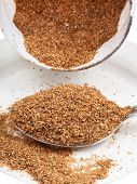 stock photo of tablespoon  - tablespoon of dried wheat bran macro view - JPG