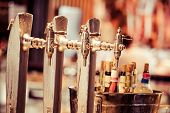 foto of over counter  - Glass of beer on pub over blurred background - JPG
