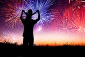 stock photo of boy girl shadow  - father with child standing on the hill and watching the fireworks - JPG
