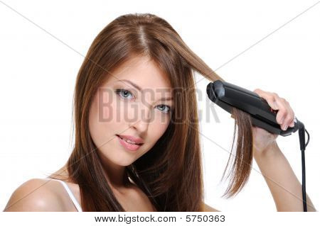 Girl Doing Hairstyle With Flat Iron