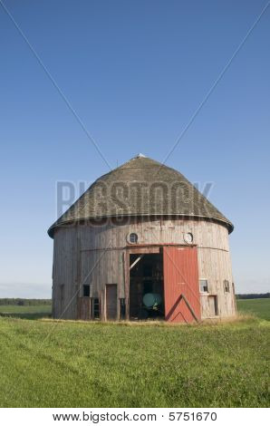 Old Round Barn In Field