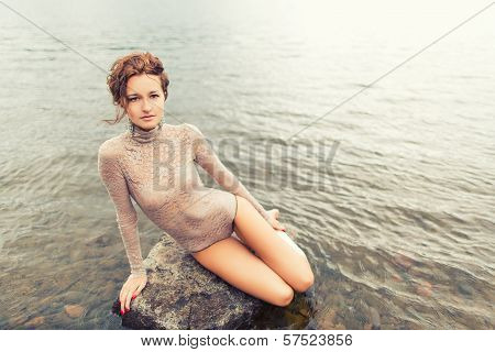 Girl on the stone