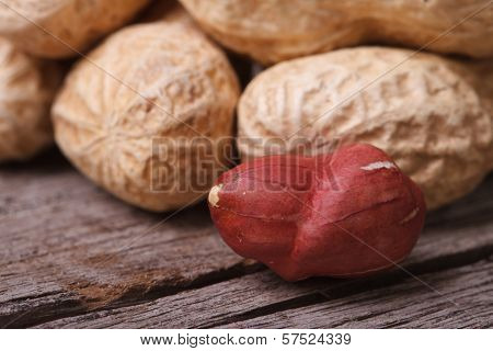 Peeled Peanuts And Peanuts In Shell Closeup