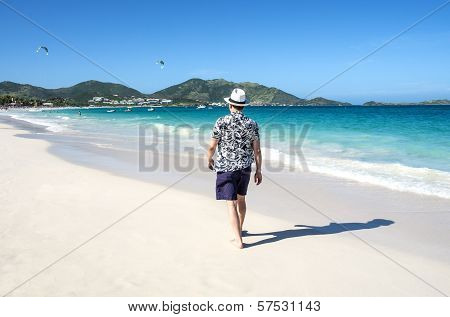 Man Walking on a Caribbean Beach