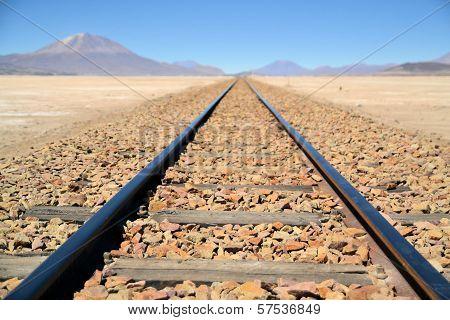 Endless Train Tracks In The Desert