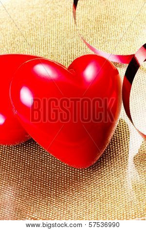 Two Red Hearts On Golden Plate Close Up. Valentines Day Background. Valentines Day Card
