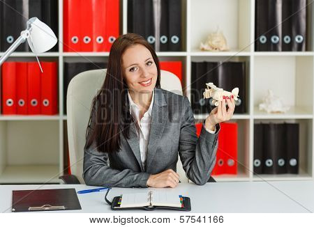 Businesswoman With A  Model Of Plane.