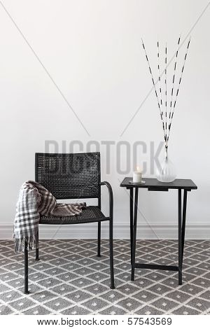 Home Decor. Armchair And Table With Decorations