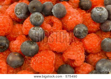 Vivid Raspberries And Blueberries
