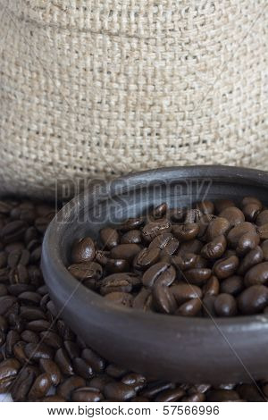Coffee Beans In A Clay Pot