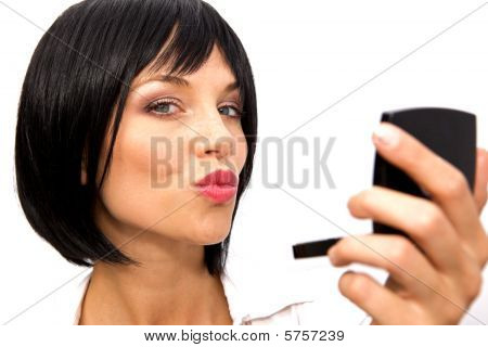 Beautiful Woman Checking Her Makeup