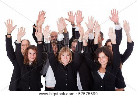 Group Of Business People Waving In Acknowledgemnt