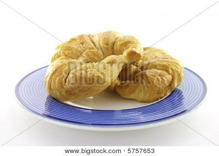 Two Croissants On A Plate