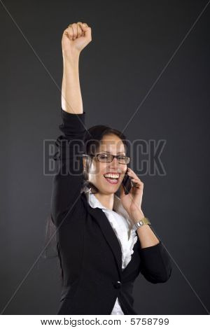 attractive businesswoman on the phone winning