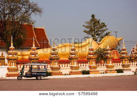 Vientiane, Laos - March 16, 2013: Golden Reclining Buddha At Wat That Luang Tai Temple