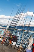 stock photo of street-rod  - rods for travelers on Galata Bridge in the Golden Horn in Istanbul - JPG