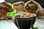 foto of bengal-gram  - raw chickpeas in a brown bowl with herbs - JPG