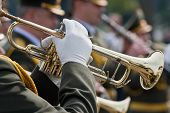 stock photo of trumpet  - Military brass band musicians with trumpets at parade - JPG