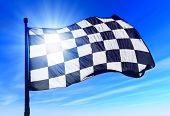 Checkered flag waving on the wind