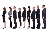 image of lineup  - Long line of diverse professional business people standing in a queue in profile isolated on white - JPG