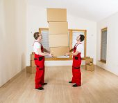 picture of movers  - Movers in new house with lot of boxes - JPG