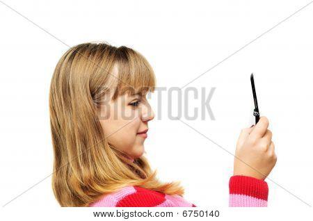 Teenager Girl Looking On Mobile Phone