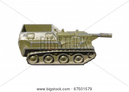 Children's toy: a very old self-propelled Artillery installation of metal green isolated on white ba