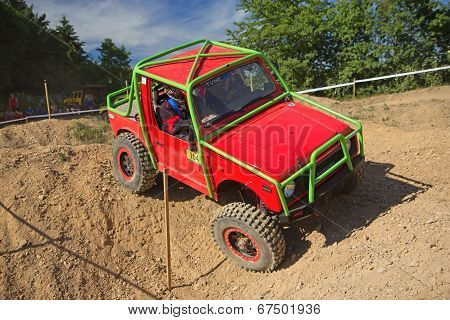 Small Red Off Road Car On The Trial Race