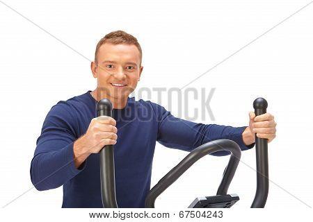 Man Uses Elliptical Cross Trainer.
