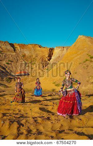 Tribal Dancers. Women In Ethnic Costumes.