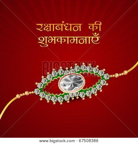 Beautiful rakhi on maroon background on the occasion of Happy Raksha Bandhan festival.