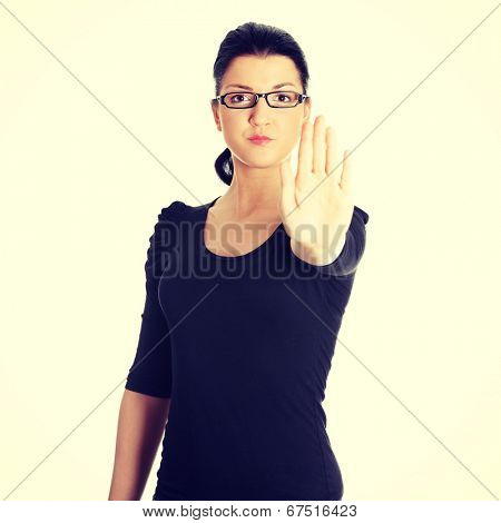 Hold on, Stop gesture showed by young woman hand.