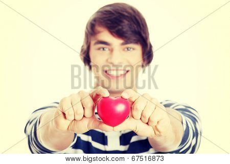 Young man with heart shaped toy