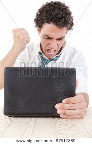 Pissed Off Caucasian Business Male Frustrated With Work Sitting In Front Of Laptop With His Hand Fis
