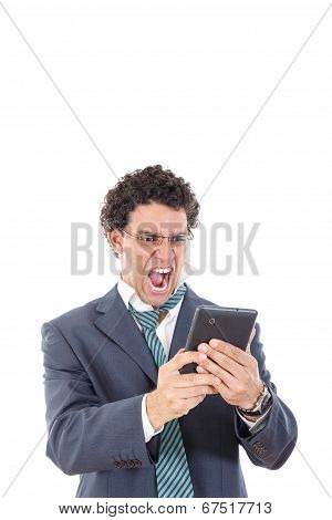 Upset, Pissed Off And Tired Man In Suit Uses Tablet For Work Or For Private Purpose