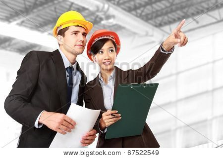 Male And Female Architect At Construction Site