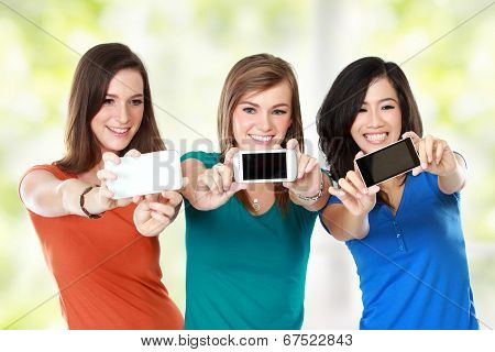 Girl Friends Taking A Picture Of Themselves