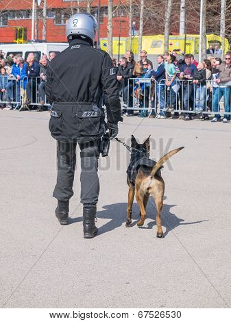 Dutch Swat Team Member And Dog In Action