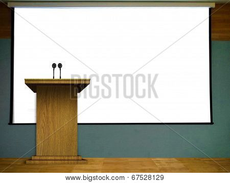 Podium On Stage With Blank Projector Screen