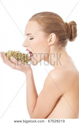 Beautiful caucasian woman with green fresh cress.