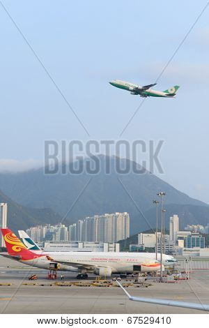 HONG KONG - APRIL 17: EVA Air jet flight take-off from airport on April 17, 2014 in Hong Kong. Hong Kong International Airport is the one of the best airport in the annual passenger survey by Skytrax.