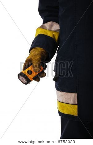 Firefighter holding a torch