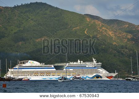 MARMARIS, TURKEY - MAY 15, 2014: Cruise ship AIDAdiva exit from the bay of Marmaris. AIDA ships cater to the German-speaking market, and has 94% average guests satisfaction rate