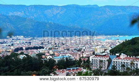 MARMARIS, TURKEY - APRIL 16, 2014: View to the bay and the city at evening. Marmaris population increases 10 times during the tourism season, and its nightlife rivals anything on the Turkish coast