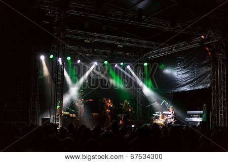 LOULE - JUNE 26: Ala dos Namorados, traditional band from Portugal, performs on stage at festival med, a world music festival, in Loule, Portugal, June 26, 2014