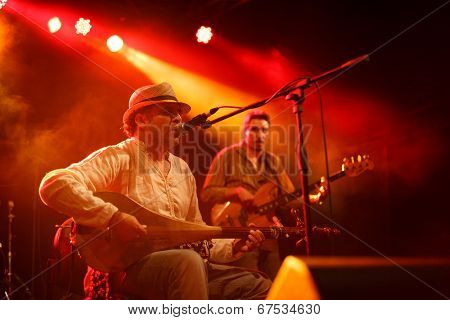 LOULE - JUNE 27: Moroccan instrumentalist and singer Nour Eddine performs on stage at festival med, a world music festival, in Loule, Portugal, June 27, 2014